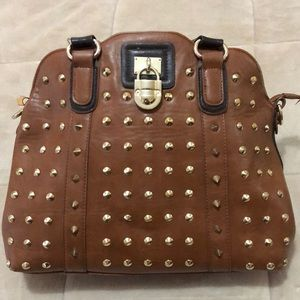Spike studded faux leather handbag